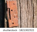 Old Iron Rusty Hinge Of Wooden...