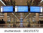 DUBAI, UNITED ARAB EMIRATES-FEBRUARY 10, 2014 English/Arabic Airport Signs showing directions of gates and check in at the Dubai International Airport.February 10, 2014, Dubai, United Arab Emirates - stock photo