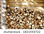Stacked Firewood Near The Wall...