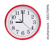 nine o'clock on a red round dial