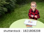 A Little Boy Drawing A Picture...