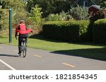 A Cyclist With A Red Coat ...