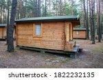 Camping Wooden Cabin In A Pine...