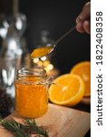 Small photo of Orange marmalade / orange jam in glass jar. A confiture is any fruit jam, marmalade, paste or fruit stewed in thick fruity syrup. Orange marmalade & fruit jam in glass jar concept. Copy space.