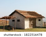 Old Wood Log Shed With Thatch...