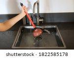 Overflowing Kitchen Sink ...