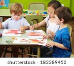 three children painting with... | Shutterstock . vector #182289452
