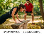 Woman Doing Push Ups In The...