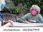 Mature Woman Wearing Mask...