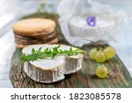 Selection of French Normandy Cheese, Camenbert, Livarot, N uchatel,white grapes