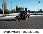 Man Rides A Motorcycle In The...