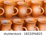 Brown Clay Pots Are In Rows....