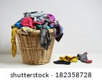 Stock photo overflowing laundry basket household chore concept on white background 182358728