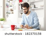 young small business owner... | Shutterstock . vector #182370158