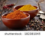 Various Spices On A Dark Woode...