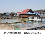 """Small photo of ADA CIGANLIJA, BELGRADE / SERBIA - JULY 7 2012: Raft restaurant """"Dorotea"""", and other buildings built on rafts at the end of piers jutting out from the right bank of the Sava River."""