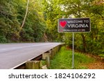 Small photo of Welcome to Virginia sign located at the Maryland, Virginia state border at Purcellville, Virginia. The black sign has a red heart shape and 'Virginia is for lovers' slogan underneath.