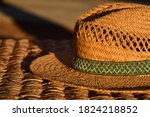 An Old Straw Hat Lies In The...