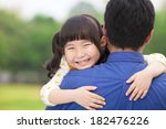 happy little girl hugging... | Shutterstock . vector #182476226