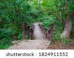 An Uneven Wooden Bridge...