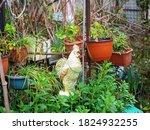 A Garden Ceramic Figurine Of A...