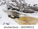 partly frozen stream or river... | Shutterstock . vector #182498312