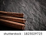 Cinnamon Sticks On Black Stone...