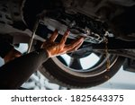 Car mechanic drain the old...
