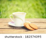 ginger cookies and a cup of... | Shutterstock . vector #182574395