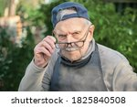 Tired Old Man Looks At His...