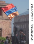 Small photo of Yerevan, Armenia - April, 23, 2018: Armenia people Raising the Flag of Armenia in Freedom square in Yerevan city. Blurred Vertical perspective.