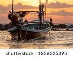 A Longtail Boat Lies At Anchor...