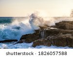 Big Wave Crashes Against The...