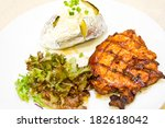 pork steak with baked potato | Shutterstock . vector #182618042