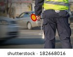 Traffic Cop Checking The...
