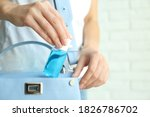 Woman putting hand sanitizer in ...