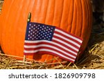 American Flag By A Pumkin