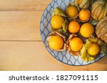 Small photo of Gape gooseberries and natural background. Cape gooseberry on wooden table. Cape Gooseberry from top view. fresh cape gooseberry background , selective focus .