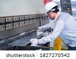 Asian technician worker wearing ...