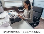 Woman In Office At Her Desk...