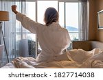 Back View Of Woman In Bathrobe...