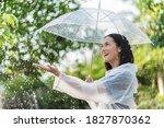 Rainy Day Asian Woman Wearing A ...