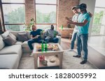 Small photo of Full length photo of fellows man gathering man play game use virtual reality device blonde hair guy hold hand try search his pals sit cozy couch enjoy in house indoors