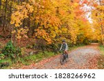 Autumn Biking Happy Woman...