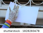 a woman's hand wearing medical... | Shutterstock . vector #1828283678