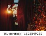 Jolly Santa Claus Sneaks Into...