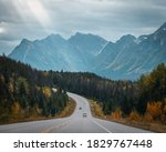 Vehicles passing each other on the Icefields Parkway highway in Alberta, Canada during autumn
