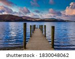 Jetty In Lake At Sunset