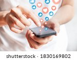 Small photo of Person interacting on social media network with smartphone by liking and loving posts. Advertising on mobile phone by collecting user data and targeting profiles