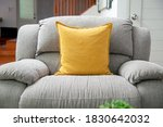 Small photo of soften yellow pillow on the grey sofa